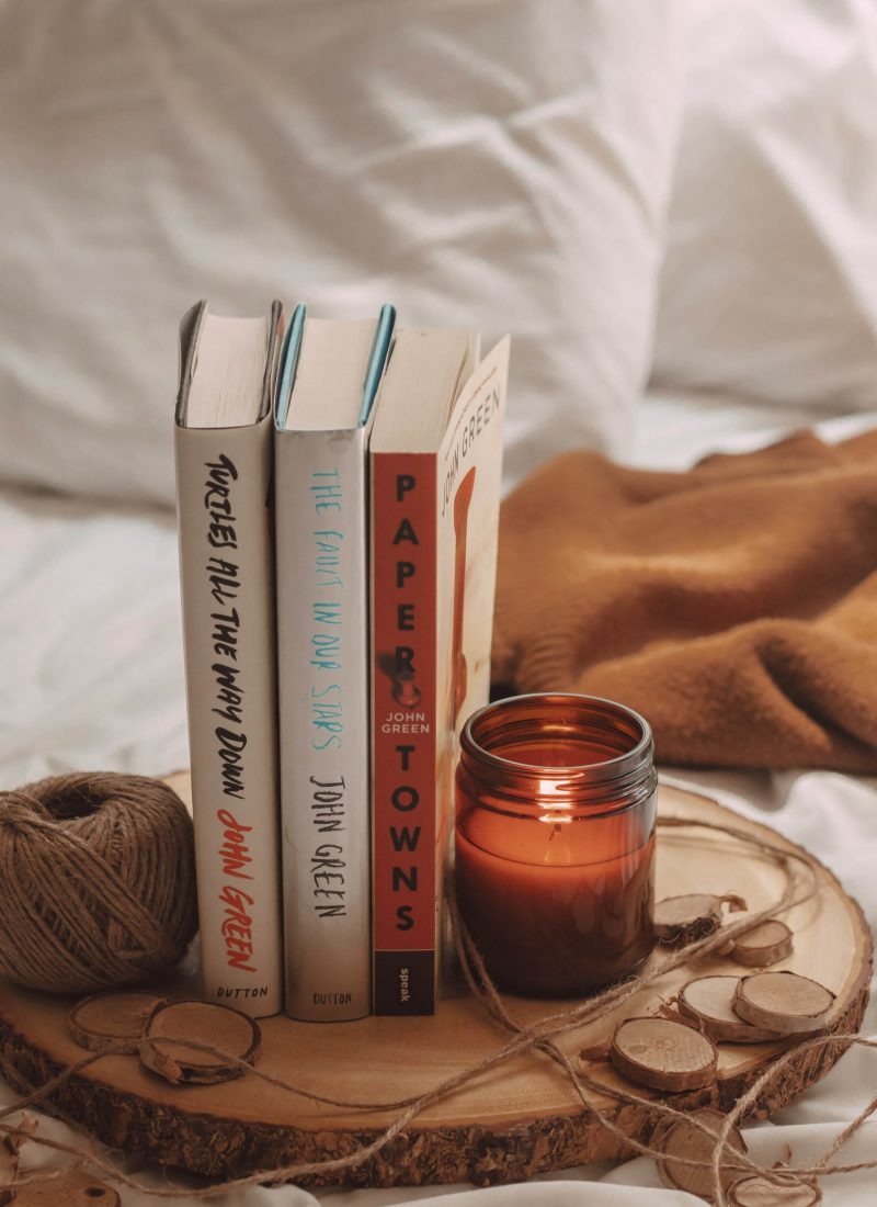 paper towns, the fault in our stars, and turtles all the way down books by john green in between a lit candle and a spool of twine