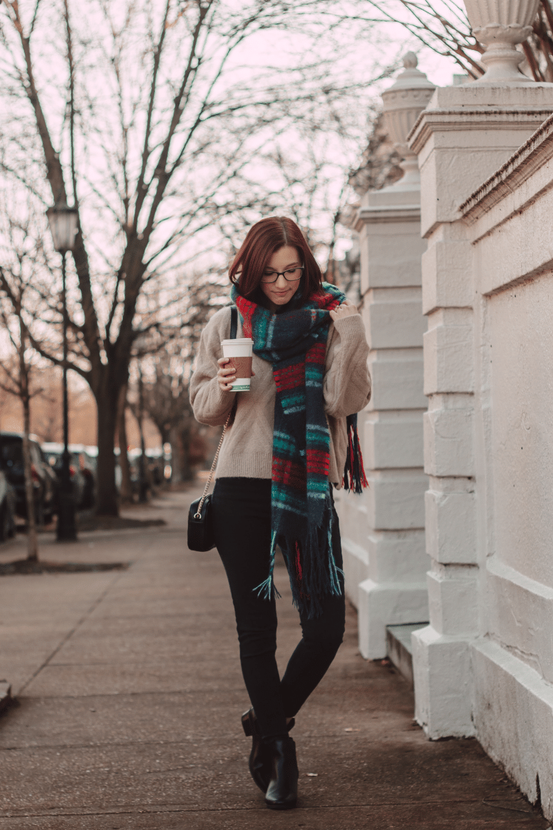 girl with long scarf and taupe sweater in city