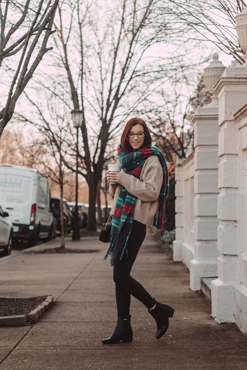 girl in city with plaid scarf winter outfit for cold