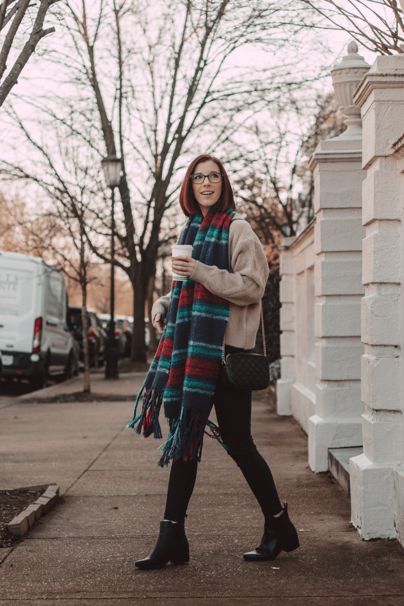 girl with coffee wearing plaid scarf winter outfit