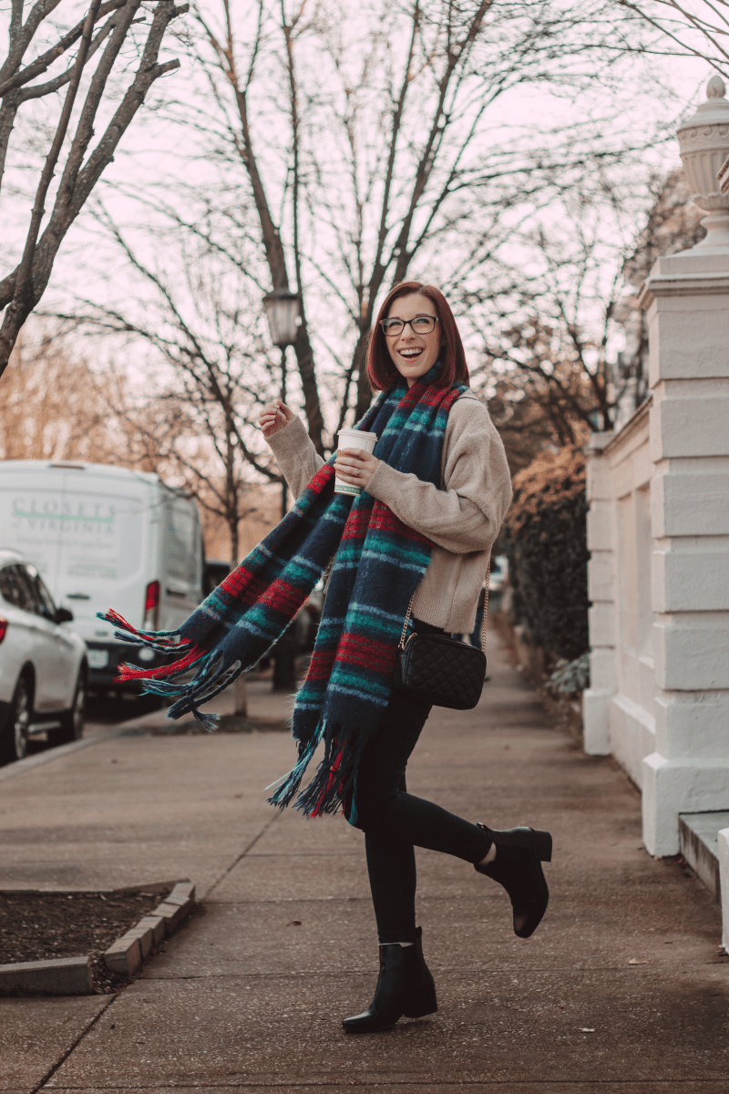 girl walking in city with plaid wool scarf