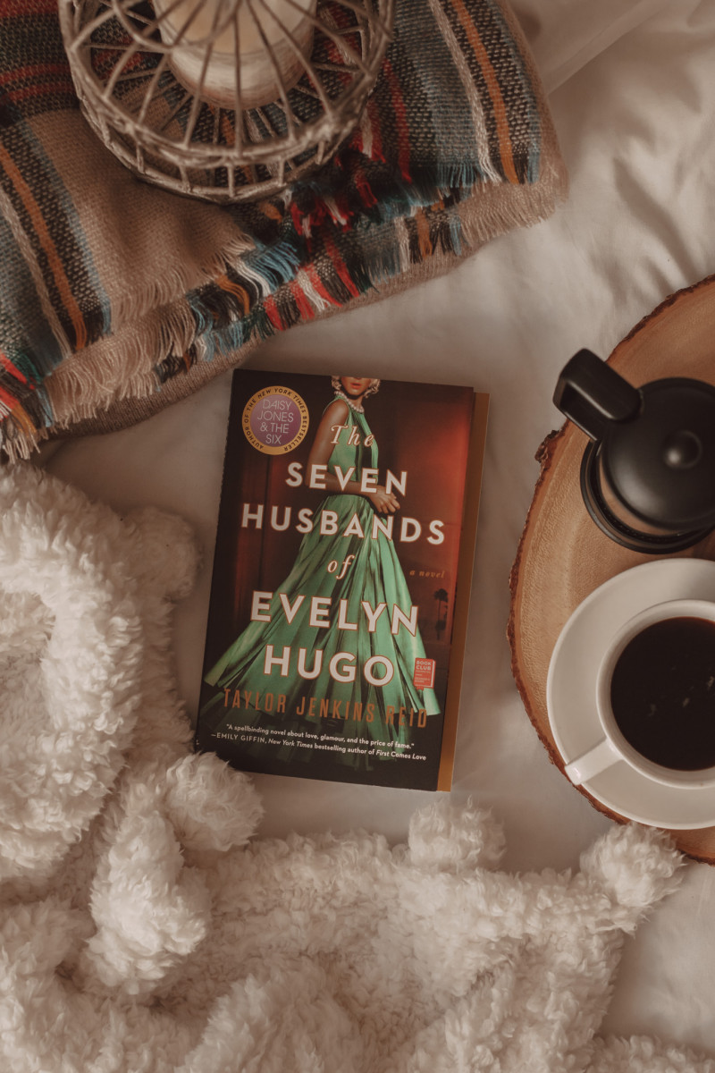 the seven husbands of evelyn hugo by taylor jenkins reid book with fluffy blanket and mug of coffee